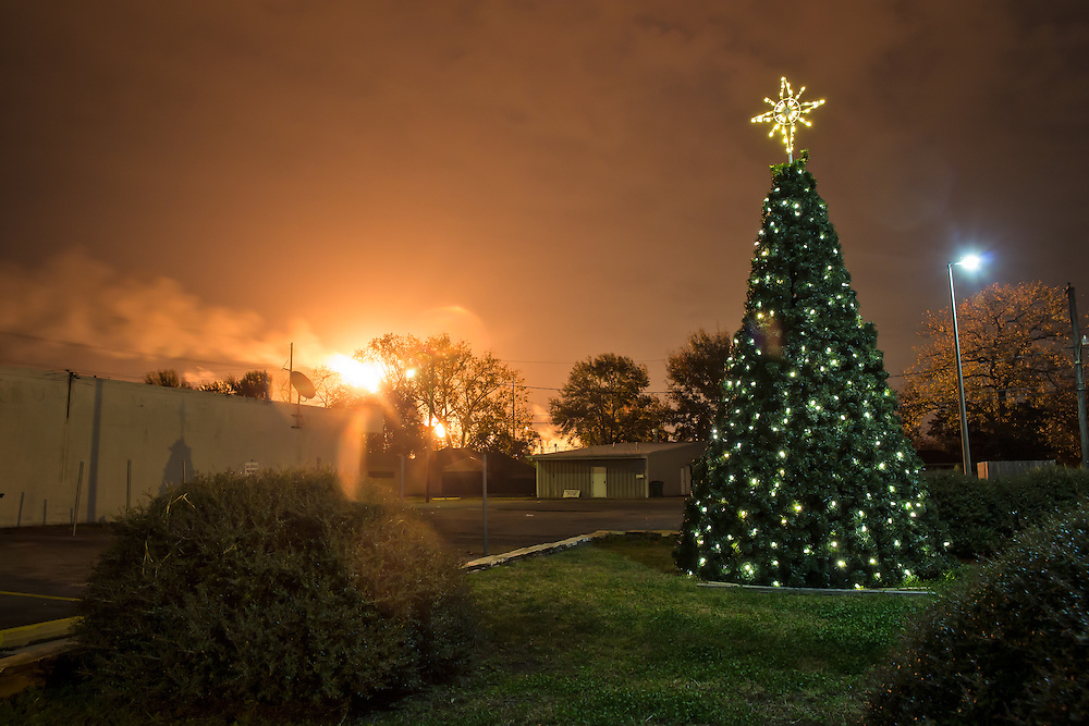 "December 19th, 2013, Norco Louisiana, A flare from the Shell Refinery shines along with Christmas lights on residents homes. Norco is part of a corridor between Baton Rouge and New Orleans known to those in Industry and the 'petrochemical corridor' and to locals as ""cancer alley"". '"