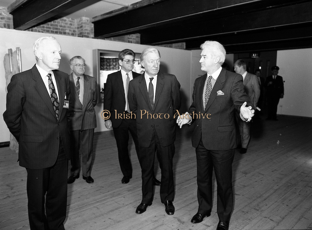 19/08/1988<br /> 08/19/1988<br /> 19 August 1988<br /> Taoiseach visits ROSC '88 at the Guinness Hop Store, Dublin. Pat Murphy ROSC Chairman (right)  explains an exhibit to Taoiseach Charles Haughey (centre) and Mr Brian Slowey, (left) Managing Director, Guinness,Ireland.