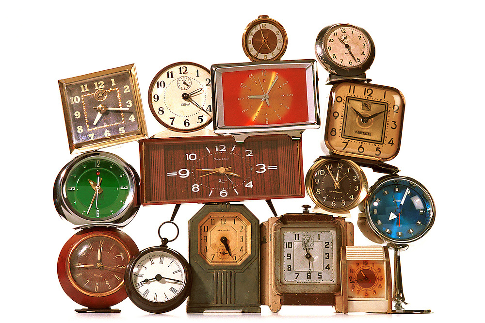 A collection of clocks on a white background.