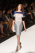 A gray, white and black knee-length print paneled skirt, and a white blue and black top.
