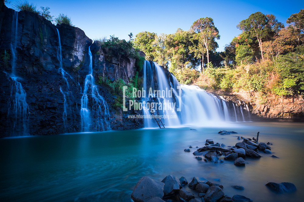 Morning light at Tad Lo waterfalls in Laos.