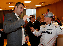 STUTTGART, GERMANY - Monday, January 25, 2010: Michael Schumacher and boxer Vitali Klitschko during the Mercedes GP Petronas Formula One Team presentation at the Mercedes-Benz Museum. (Pic by Juergen Tap/Hoch Zwei/Propaganda)