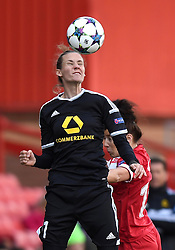 FFC Frankfurt's Simone Laudehr heads the ball away from Bristol Academy's Angharad James - Photo mandatory by-line: Paul Knight/JMP - Mobile: 07966 386802 - 21/03/2015 - SPORT - Football - Bristol - Ashton Gate Stadium - Bristol Academy v FFC Frankfurt - UEFA Women's Champions League