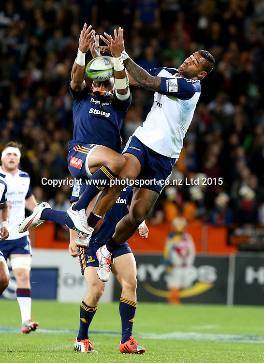 Highlanders Patrick Osborne, left, and Blues Frank Halai compete for high ball during the Super 15 rugby match between the Highlanders and the Blues at Forsyth Barr Stadium, Dunedin, Saturday, April 18, 2015. Photo: Dianne Manson / www.photosport.co.nz