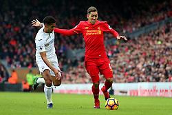 Roberto Firmino of Liverpool takes on Kyle Naughton of Swansea City  - Mandatory by-line: Matt McNulty/JMP - 21/01/2017 - FOOTBALL - Anfield - Liverpool, England - Liverpool v Swansea City - Premier League
