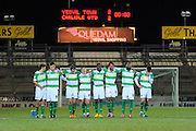 Yeovil players stand at the centre circle watching the penalty shoot-out during the The FA Cup Third Round Replay match between Yeovil Town and Carlisle United at Huish Park, Yeovil, England on 19 January 2016. Photo by Graham Hunt.