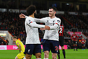 Goal - Mohamed Salah (11) of Liverpool celebrates after he scores a goal to give a 0-3 lead with Andrew Robertson (26) of Liverpool during the Premier League match between Bournemouth and Liverpool at the Vitality Stadium, Bournemouth, England on 7 December 2019.