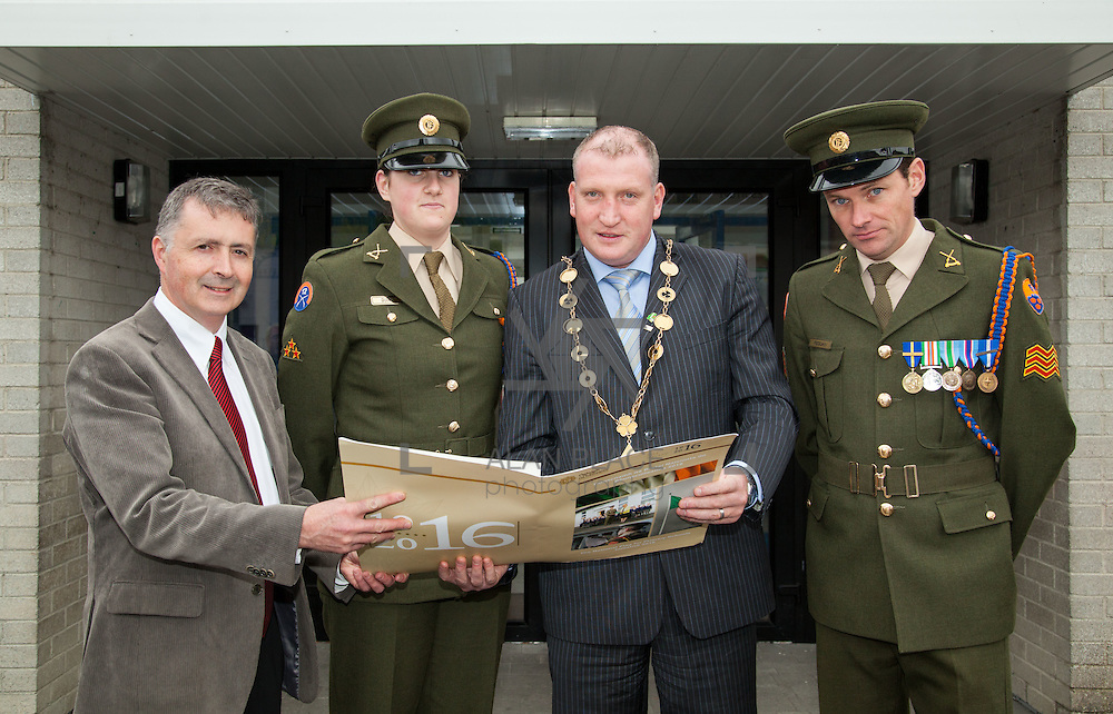 23/10/2015       <br /> Members of the Defence Forces were in Abbeyfeale today to present a handmade Tricolour and a copy of the Proclamation of the Irish Republic to students of the town's two primary schools.<br /> <br /> St Marys Boys National School and Scoil Mh&aacute;thair D&eacute; are among 3,000 schools nationally and 152 Limerick primary schools to receive the presentation as part of initiatives to mark the centenary of the 1916 Rising.&nbsp;<br /> <br /> Councillor Liam Galvin, Mayor of the City and County of Limerick joined pupils and teachers for today's presentation ceremony, which saw representatives of the Defences Forces raise the flag and read the Proclamation. <br /> <br /> Attending the ceremony at St. Marys Boys National School were, Sean Woulfe, Principal, Private Ciara Quinn, Mayor of Limerick Cllr. Liam Galvin, and Sergeant James Reddan. Picture: Alan Place.