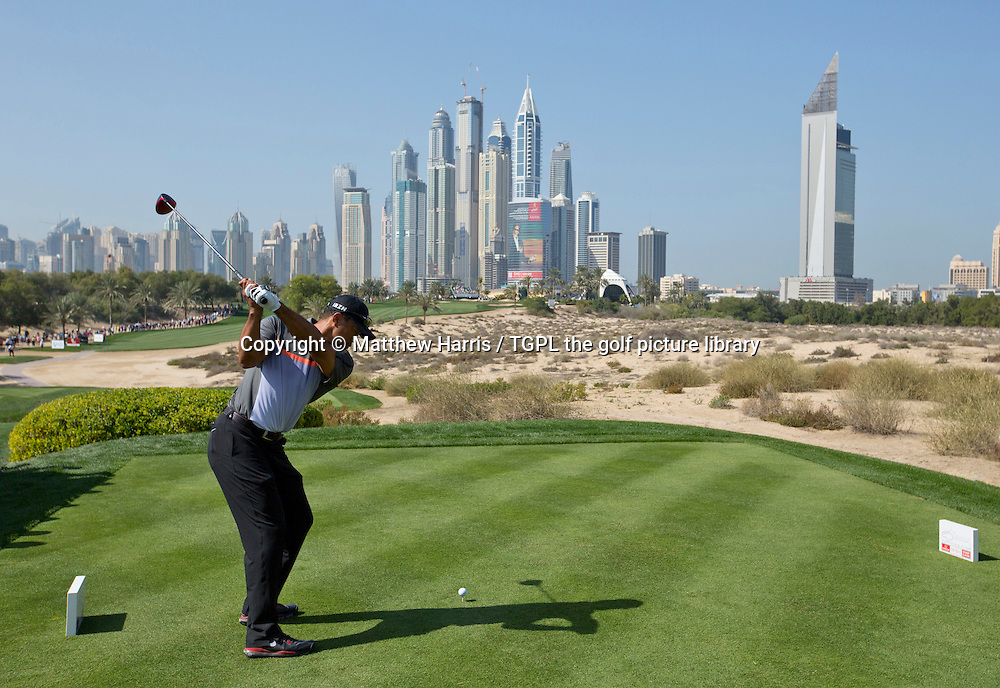 Tiger WOODS (USA) tees off the 8th par 4 with the city skyline in the background during first round  Omega Dubai Desert Classic 2014, Emirates Club,Dubai,UAE.