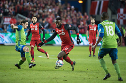 December 9, 2017 - Toronto, Ontario, Canada - Toronto FC forward JOZY ALTIDORE (17) dribbles the ball around Seattle Sounders defender GUSTAV SVENSSON (4) towards the goal while Seattle Sounders defender KELVIN LEERDAM (18) looks on during the MLS Cup championship match at BMO Field in Toronto, Canada.  Toronto FC defeats Seattle Sounders 2 to 0. (Credit Image: © Mark Smith via ZUMA Wire)