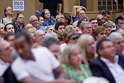 "Aug 26, 2009 -- PHOENIX, AZ: Supporters of the ""public option"" hold up signs during Sen John McCain's town hall meeting on health care at North Phoenix Baptist Church in Phoenix, AZ, Wednesday. Sen McCain hosted his second town hall meeting on health care in two days Wednesday. About 1,000 people attended the meeting. Although most were opposed to President Obama's health care proposals and supported Sen McCain, there was a large group who support the President's health care efforts.  Photo by Jack Kurtz"