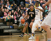 Anthony Lamb of Greece Athena dribbles up court during a game at Webster Schroeder High School on Friday, January 23, 2015.