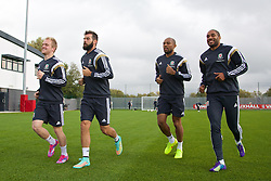 NEWPORT, WALES - Wednesday, October 8, 2014: Wales' George Williams, Joe Ledley Daniel Gabbidon and captain Ashley Williams training at Dragon Park National Football Development Centre ahead of the UEFA Euro 2016 qualifying match against Bosnia and Herzegovina. (Pic by David Rawcliffe/Propaganda)