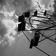 Black and white shot of a Ferris Wheel taken at a local fair.
