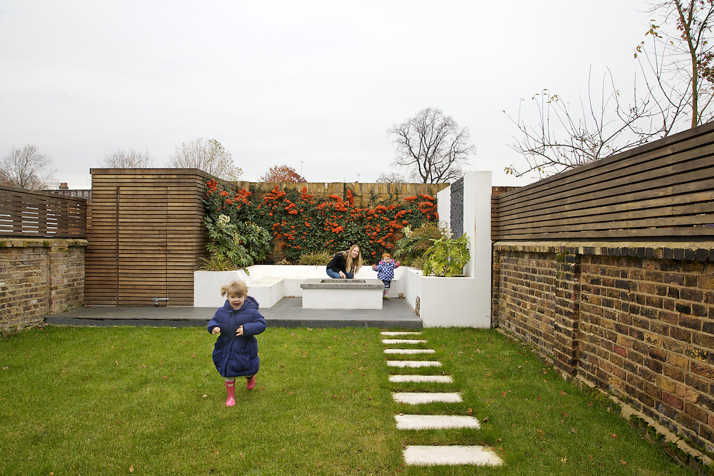 Lana Wrightman, Edie, 2 and 1/2 and Clara 18 months, in their back garden on 31 Groombridge Road, Hackney, London CREDIT: Vanessa Berberian for The Wall Street Journal<br /> HACKNEY-Lana Wrightman