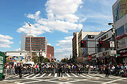 September 16, 2012- Harlem, New York: Crowd Participants at the 42nd Annual African American Day Parade held along Adam Clayton Blvd on September 16, 2012 in Harlem New York City. The first African American Day Parade was held in September 1969 in Harlem. The first Grand Marshal was Congressman Adam Clayton Powell, Jr. The purpose of the parade is to provide an opportunity for African people to join together on a Special Day to highlight history and salute African people throughout America and the world for their outstanding achievements.  (Terrence Jennings)