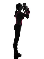 one  woman holding kissing baby silhouette on white background