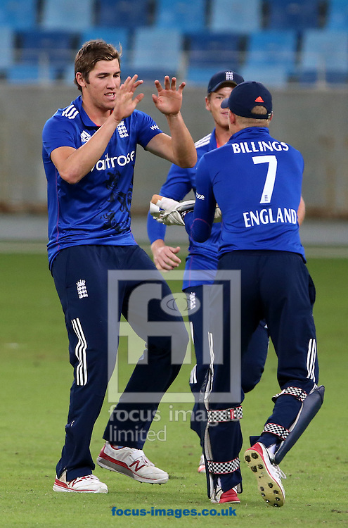 Jamie Overton of England Lions takes the wicket of Fakhar Zaman of Pakistan A during the International Twenty/20 match at Dubai International Cricket Stadium, Dubai<br /> Picture by Chris Whiteoak-Medcalf/Focus Images Ltd +971 8117530<br /> 10/12/2015