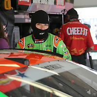 Sprint Cup Series driver Danica Patrick (10) climbs into her car in the garage area during the 57th Annual NASCAR Coke Zero 400 race first practice session at Daytona International Speedway on Friday, July 3, 2015 in Daytona Beach, Florida.  (AP Photo/Alex Menendez)