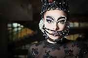 Woman in fashion clothes with mask ready for stage performance