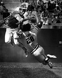 A's Manny Alexander hit by Cleveland's Rick Manning. .(1978 photo by Ron Riesterer)
