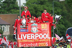 LIVERPOOL, ENGLAND - THURSDAY, MAY 26th, 2005: Liverpool players Luis Garcia, Jamie Carragher, Jerzy Dudek, Dietmar Hamann, Milan Baros, Steven Gerrard and John Arne Riise parade the European Champions Cup on on open-top bus tour of Liverpool in front of 500,000 fans after beating AC Milan in the UEFA Champions League Final at the Ataturk Olympic Stadium, Istanbul. (Pic by David Rawcliffe/Propaganda)