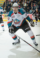 KELOWNA, CANADA, JANUARY 1: Mackenzie Johnston #22 of the Kelowna Rockets looks for the pass as the Calgary Hitmen visit the Kelowna Rockets on January 1, 2012 at Prospera Place in Kelowna, British Columbia, Canada (Photo by Marissa Baecker/Getty Images) *** Local Caption ***