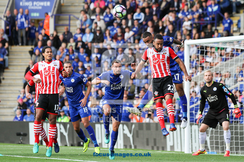 Danny Simpson of Leicester City (2nd right) heads clear under pressure from Nathan Redmond of Southampton (3rd right) during the Premier League match at the King Power Stadium, Leicester<br /> Picture by Andy Kearns/Focus Images Ltd 0781 864 4264<br /> 02/10/2016