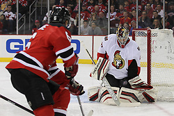 Apr 7; Newark, NJ, USA; Ottawa Senators goalie Craig Anderson (41) makes a save on New Jersey Devils defenseman Andy Greene (6) during the first period at the Prudential Center.