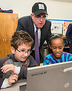Houston ISD Superintendent Dr. Terry Grier watches students work a coding exercise during an Hour of Code at Kolter Elementary School, December 10, 2014.