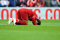 LIVERPOOL, ENGLAND - Saturday, September 22, 2018: Liverpool's Mohamed Salah kneels to pray as he celebrates scoring the third goal during the FA Premier League match between Liverpool FC and Southampton FC at Anfield. (Pic by Jon Super/Propaganda)