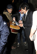18.OCTOBER.2012. LONDON<br /> <br /> RONNIE WOOD AND GIRLFRIEND SALLY HUMPHREYS HAVE DINNER WITH STEREOPHONICS FRONT MAN KELLY JONES AND HIS GIRLFRIEND JAKKI HEALY AT SCALINI RESTAURANT IN KNIGHTSBRIDGE. WHEN LEAVING RONNIE SIGNED A GUITAR AND PHOTOS FOR WAITING FANS AND THEN POSED UP WITH HIS GIRLFRIEND'S PARENTS BEFORE GETTING INTO A CAB <br /> <br /> BYLINE: EDBIMAGEARCHIVE.CO.UK<br /> <br /> *THIS IMAGE IS STRICTLY FOR UK NEWSPAPERS AND MAGAZINES ONLY*<br /> *FOR WORLD WIDE SALES AND WEB USE PLEASE CONTACT EDBIMAGEARCHIVE - 0208 954 5968*