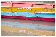 Colourful boat reflected in water, Manglares Churute Ecological Reserve