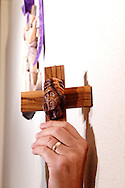 Clyde Golden of Miamisburg holds an olive wood face relief interpretation of Jesus he got in Jerusalem near station five at St. Luke the Evangelist before a performance of 'The Way of the Cross' at St. Luke Catholic Parish in Beavercreek, Friday, March 30, 2012.