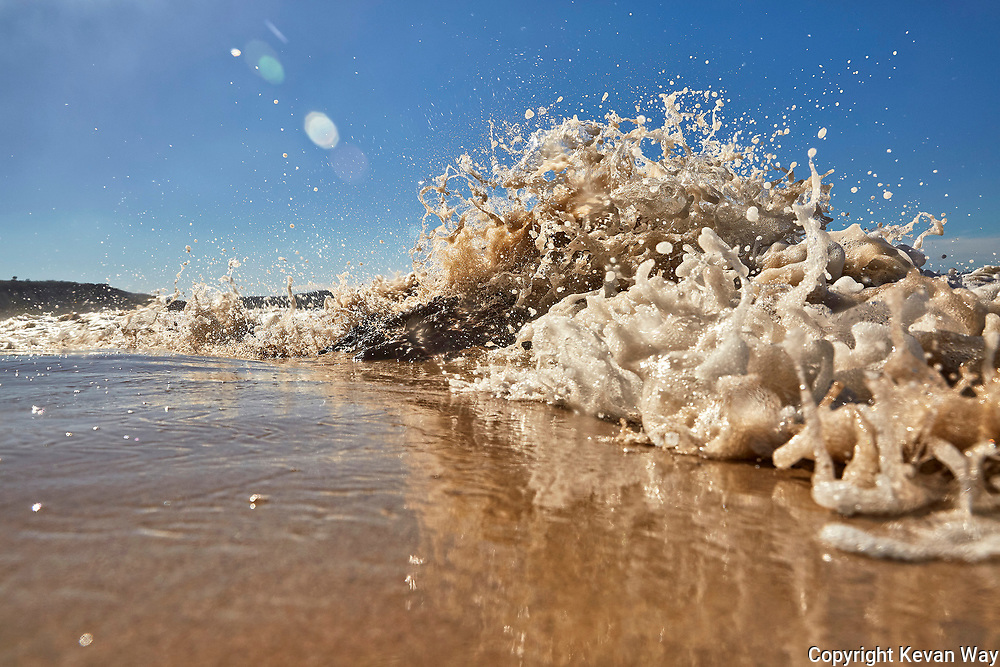 the foamy shorebreak