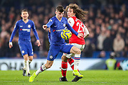 Chelsea midfielder Mason Mount (19) goes past Arsenal midfielder Mattéo Guendouzi (29) during the Premier League match between Chelsea and Arsenal at Stamford Bridge, London, England on 21 January 2020.
