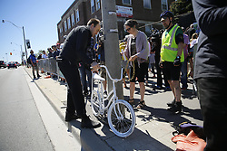 June 3, 2017 - Toronto, ONT, Canada - TORONTO, ON - June 03.  Geoffrey Bercarich who made the ghost bike(L) and Yvonne Bambride ( r) chain the bike  to the post near where the boy cyclist passed away.. 5-year-old Xavier Morgan who died last week after biking on Martin Goodman Waterfront Trail.(Rene Johnston/Toronto Star) Rene Johnston Toronto Star/Toronto Star (Credit Image: © Rene Johnston Toronto Star/The Toronto Star via ZUMA Wire)