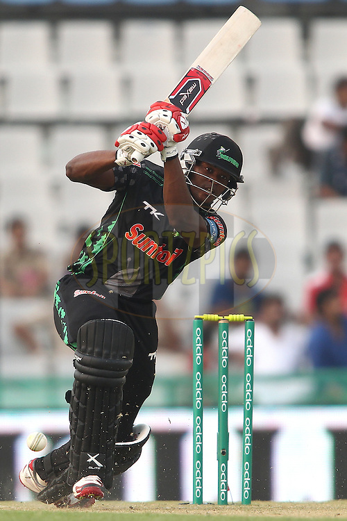 Andile Phehlukwayo of the Dolphins straight drives a delivery during match 4 of the Oppo Champions League Twenty20 between the Dolphins and the Perth Scorchers held at the Punjab Cricket Association Stadium, Mohali, India on the 20th September 2014<br /> <br /> Photo by:  Shaun Roy / Sportzpics/ CLT20<br /> <br /> <br /> Image use is subject to the terms and conditions as laid out by the BCCI/ CLT20.  The terms and conditions can be downloaded here:<br /> <br /> http://sportzpics.photoshelter.com/gallery/CLT20-Image-Terms-and-Conditions-2014/G0000IfNJn535VPU/C0000QhhKadWcjYs