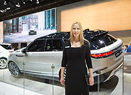 "Manhattan, New York, USA. April 12, 2017. Female rep stands in front of Land Rover 2018 Range Rover VELAR, medium SUV, makes its North Amerian launch at the New York International Auto Show, NYIAS, during the first Press Day at the Javits Center. The Latin word ""velare"" means to veil or cover, and Velar was what Range Rover engineers called pre-production prototypes Range Rovers in the 1960s."