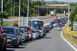 &copy; Licensed to London News Pictures. 23/07/2016<br /> Traffic coming off M20 at Junction 11.<br /> Dover bound traffic and local traffic coming OFF the M20 at Junction 11 and heading towards Hythe to avoid the queueing traffic into Dover because of very long delays at French border contol. <br /> <br /> <br /> (Byline:Grant Falvey/LNP)