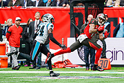 Tampa Bay Buccaneers Wide Receiver Mike Evans (13) juggles the ball but cant keep hold of it during the International Series match between Tampa Bay Buccaneers and Carolina Panthers at Tottenham Hotspur Stadium, London, United Kingdom on 13 October 2019.