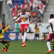 Roy Miller, New York Red Bulls, heads clear during the New York Red Bulls Vs Arsenal FC,  friendly football match for the New York Cup at Red Bull Arena, Harrison, New Jersey. USA. 26h July 2014. Photo Tim Clayton