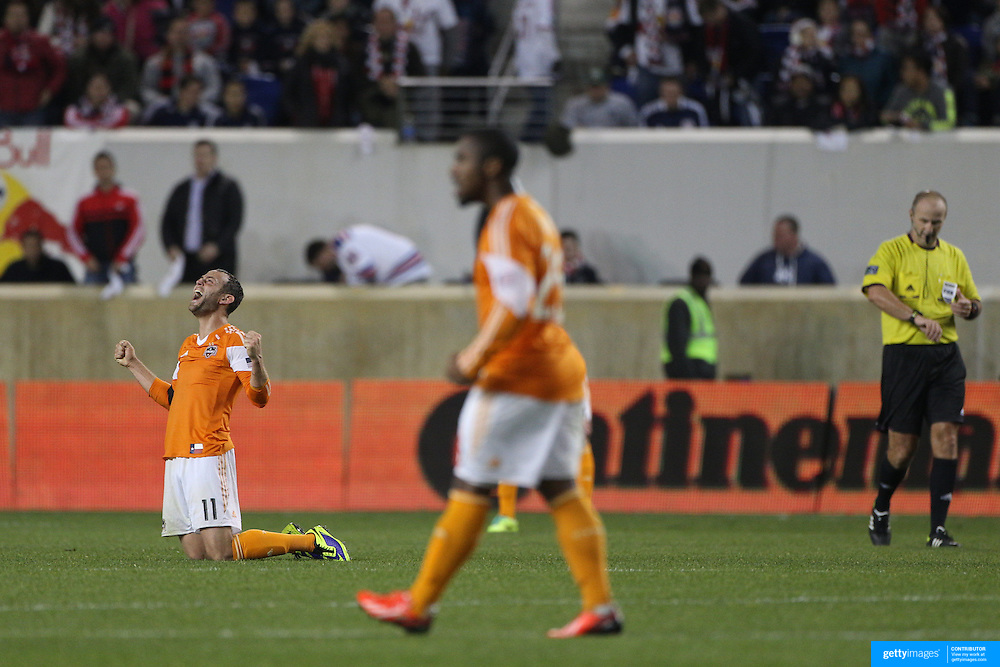 Brad Davis, (left), Houston Dynamo, celebrates at the final whistle during the New York Red Bulls V Houston Dynamo, Major League Soccer second leg of the Eastern Conference Semifinals match at Red Bull Arena, Harrison, New Jersey. USA. 6th November 2013. Photo Tim Clayton