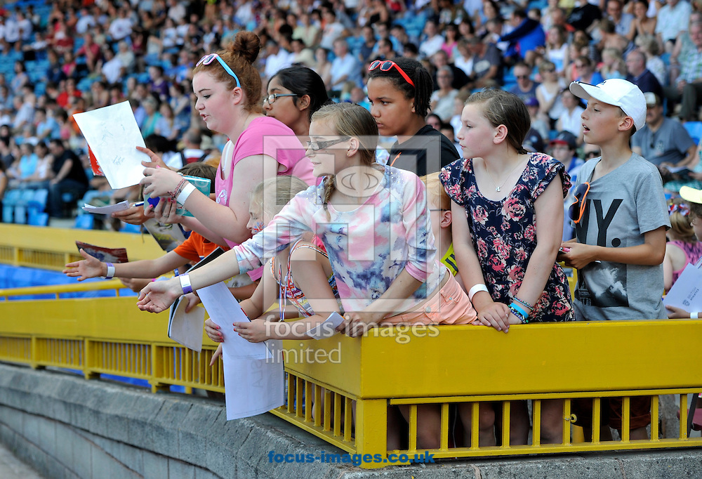 Picture by Alan Stanford/Focus Images Ltd +44 7915 056117<br /> 12/07/2013<br /> Fans wanting autographs pictured during day two of Sainsbury's British Championship at Alexander Stadium, Birmingham.