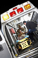 Person receiving medical aid inside ambulance