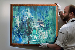 "© Licensed to London News Pictures. 03/06/2016. London, UK. A staff member shows Boris Anisfeld's ""Sadko, the underwater kingdom"" (est. GBP 25,000-35,000), at a preview of Sotheby's Russian and contemporary central and eastern European art sale which takes place in London on 7 June. Photo credit : Stephen Chung/LNP"