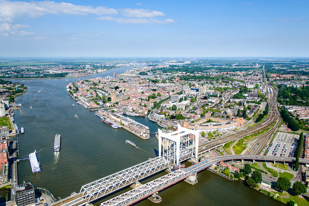 Nederland, Zuid-Holland,  Dordrecht, 10-06-2015; Gezicht op Dordrecht met spoorbrug over de Oude Maas tussen Dordrecht en Zwijndrecht. Binnenstad met Kalkhaven en Grote Kerk, Beneden Mewede aan de horizon.<br /> View of Dordrecht with railway bridge over the Oude Maas between Dordrecht and Zwijndrecht.<br /> luchtfoto (toeslag op standard tarieven);<br /> aerial photo (additional fee required);<br /> copyright foto/photo Siebe Swart