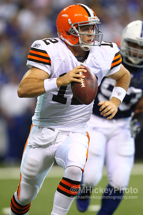 Sept. 18, 2011; Indianapolis, IN, USA; Cleveland Browns quarterback Colt McCoy (12) scrambles out of the pocket against the Indianapolis Colts at Lucas Oil Stadium.  Mandatory credit: Michael Hickey-US PRESSWIRE