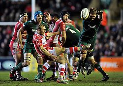 Dan Robson of Gloucester Rugby box-kicks the ball as Jamie Gibson of Leicester Tigers looks to charge him down - Photo mandatory by-line: Patrick Khachfe/JMP - Mobile: 07966 386802 13/02/2015 - SPORT - RUGBY UNION - Leicester - Welford Road - Leicester Tigers v Gloucester Rugby - Aviva Premiership