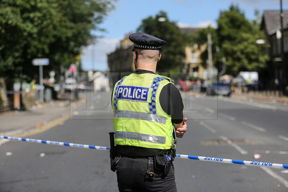 © Licensed to London News Pictures. 29/08/2016. Leeds, UK. Police guard what is believed to be the scene of shooting that took place last night. This is as yet unconfirmed by the police. The incident happened in the Chappeltown area of Leeds where the West Indian Carnival is taking place this weekend. Photo credit : Ian Hinchliffe/LNP